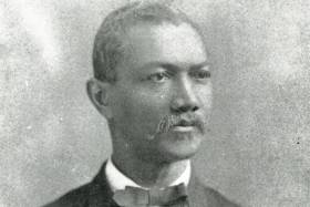Black and white portrait of Dr. Alexander T. Augusta looking solemnly into distance