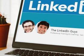 LinkedIn Guys page on a laptop