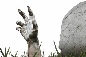 Hand reaching out of a grave.