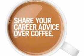 Top view of a cup of coffee with white writing - Share you career advice over coffee