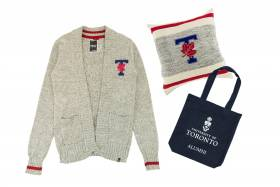 Retro-style U of T cardigan, U of T knitted pillow, U of T alumni tote bag