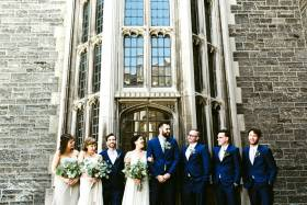 A beaming bridal party in front of U of T