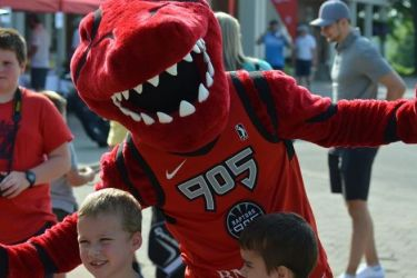 Raptors 905 mascot posing with kids