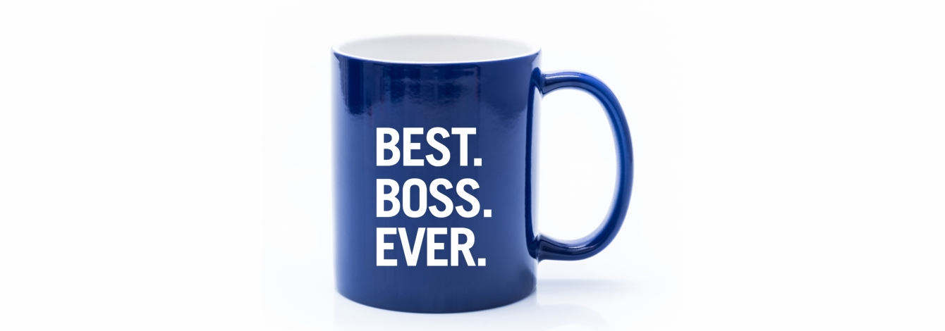 "Blue coffee mug with the words ""Best. Boss. Ever."" written in large, block letters."