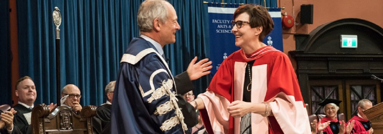 Cindy Blackstock speaks with U of T President Meric Gertler as she receives a Doctor of Laws, honoris causa, from U of T on Monday (photo by Lisa Sakulensky)